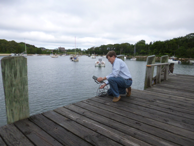 PondWatch Coordinator and FWS Board Member Ted Schmuhl collects a sample at Quissett.
